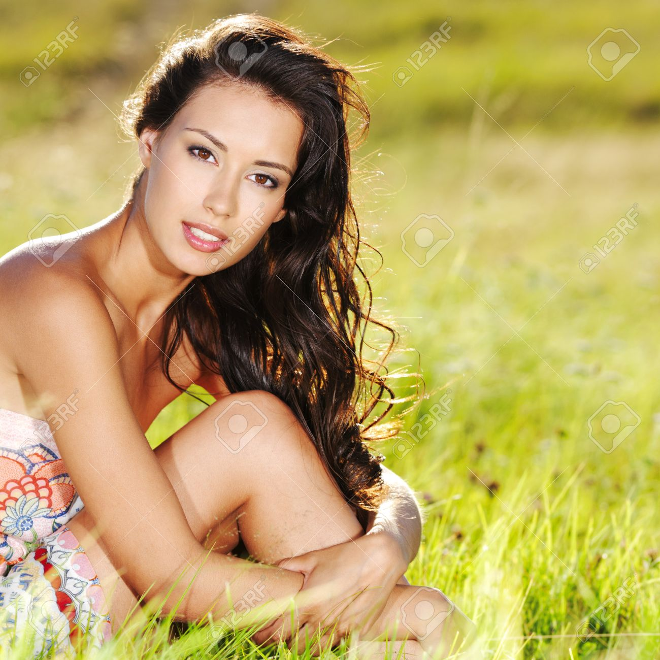 Portrait of an young beautiful sexy woman on the nature Stock Photo - 53558590
