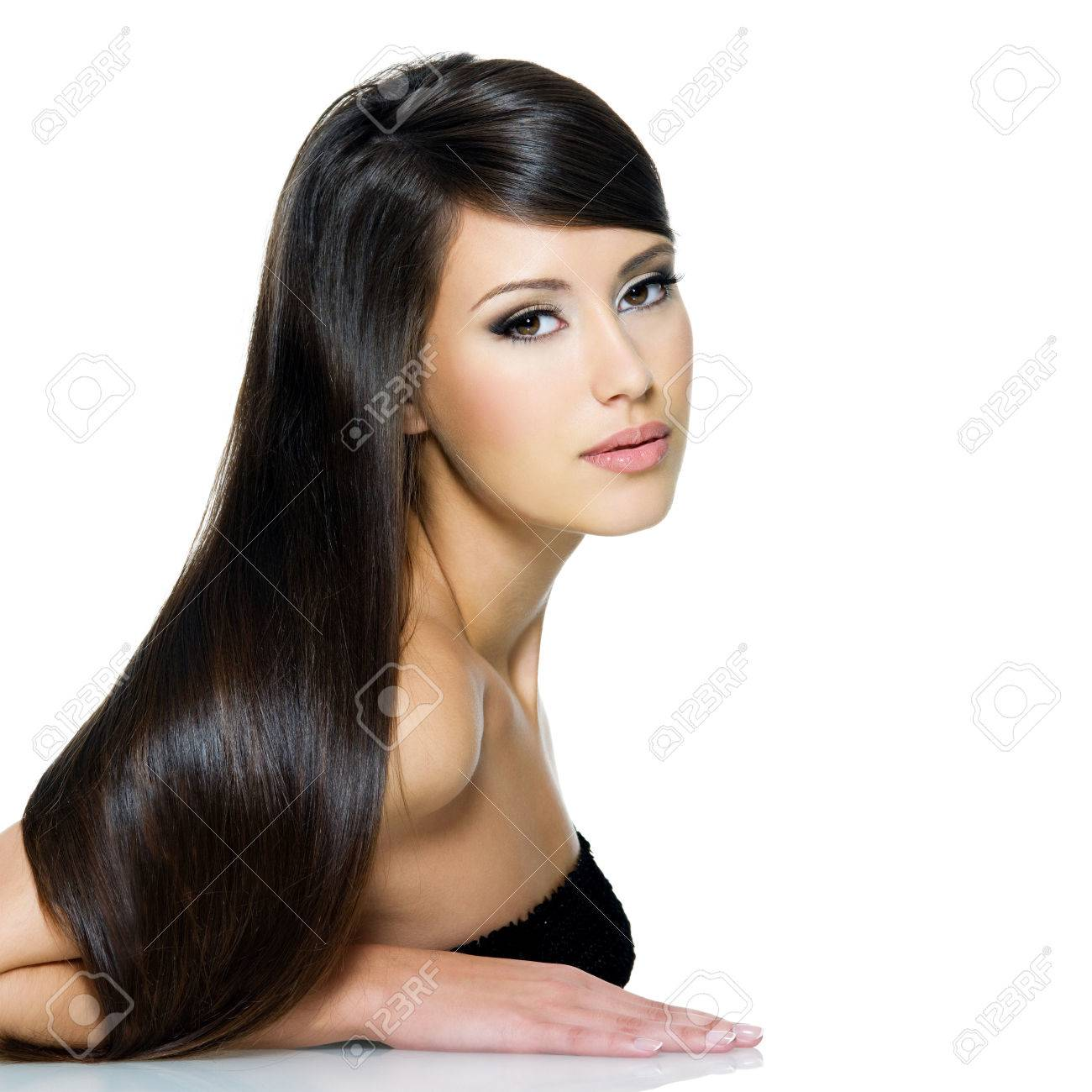Portrait of beautiful young woman with long straight brown hair posing isolated on white background Stock Photo - 53558591