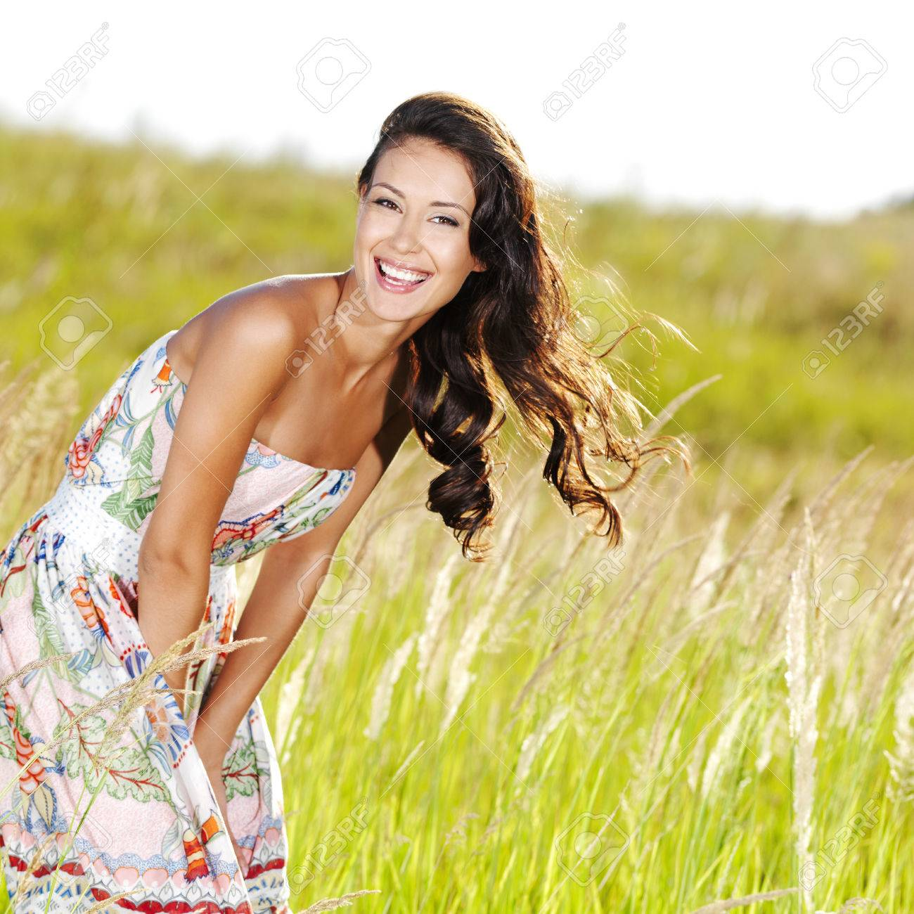 Portrait of the young beautiful smiling woman outdoors Stock Photo - 53558592