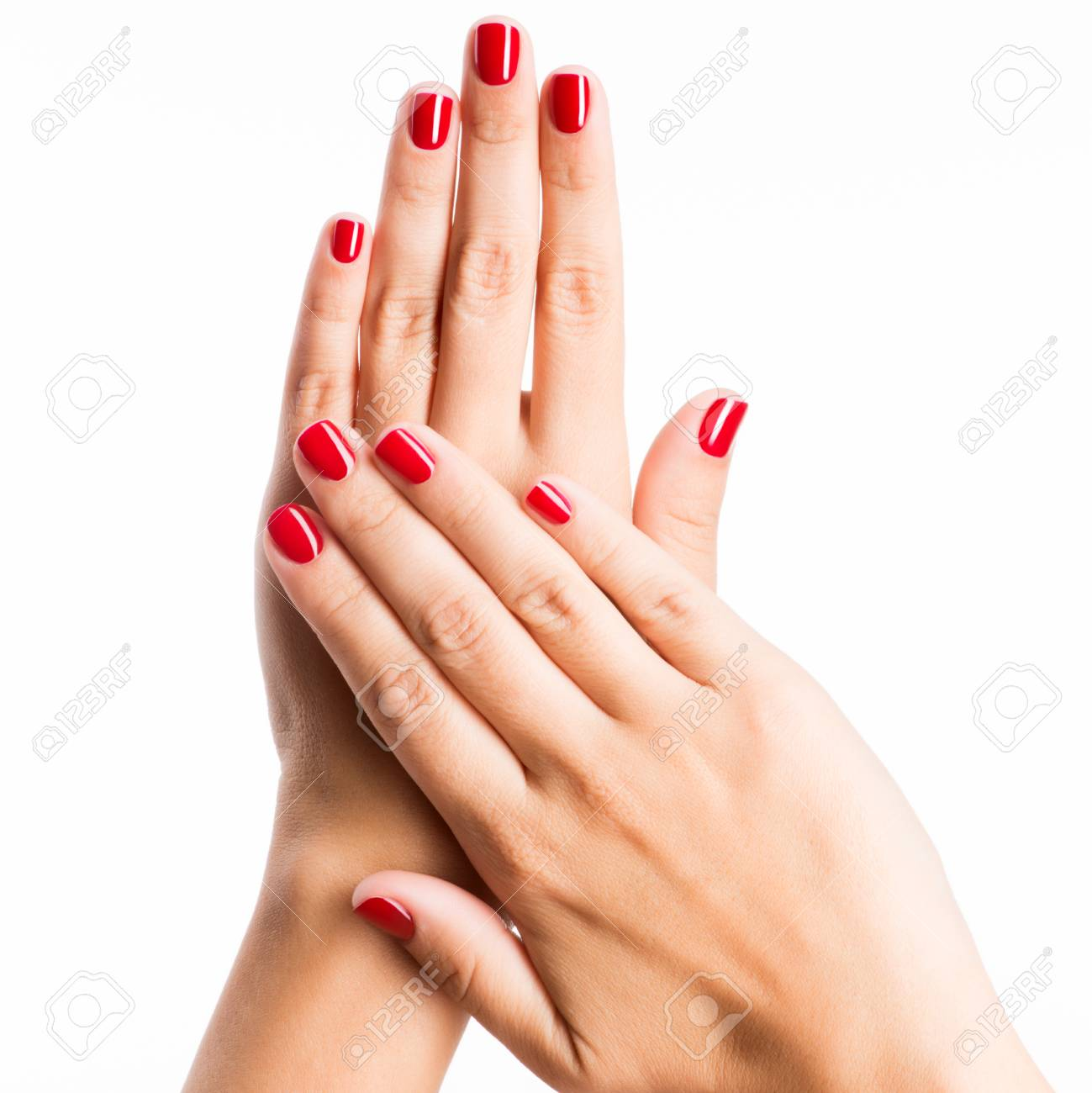Closeup photo of a beautiful female hands with red nails isolated on white background - 53558747