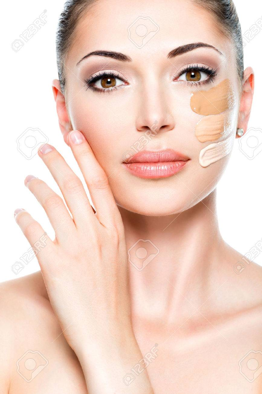 Beautiful face of young woman with cosmetic foundation on a skin. Beauty treatment concept - 53558984
