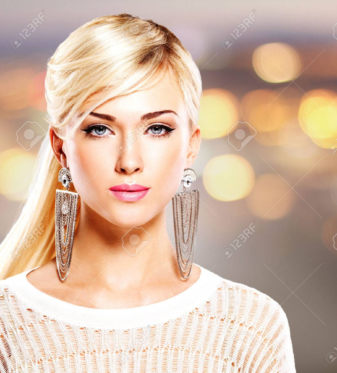 Portrait of a beautiful woman with bright pink lips and fashion makeup. Model posing at studio on the art background - 53559202