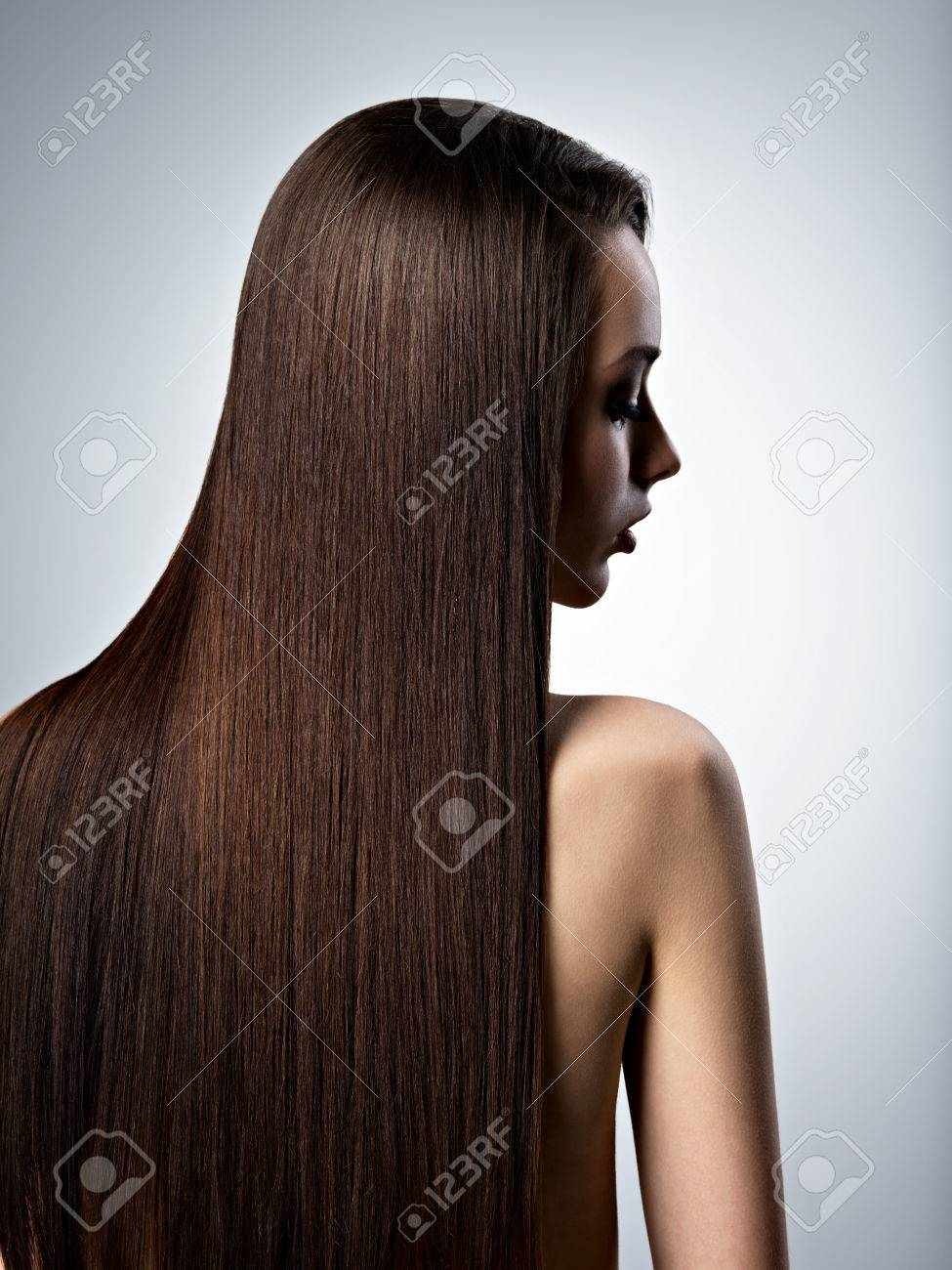 Portrait of beautiful woman with long straight brown hair at studio - 54099851