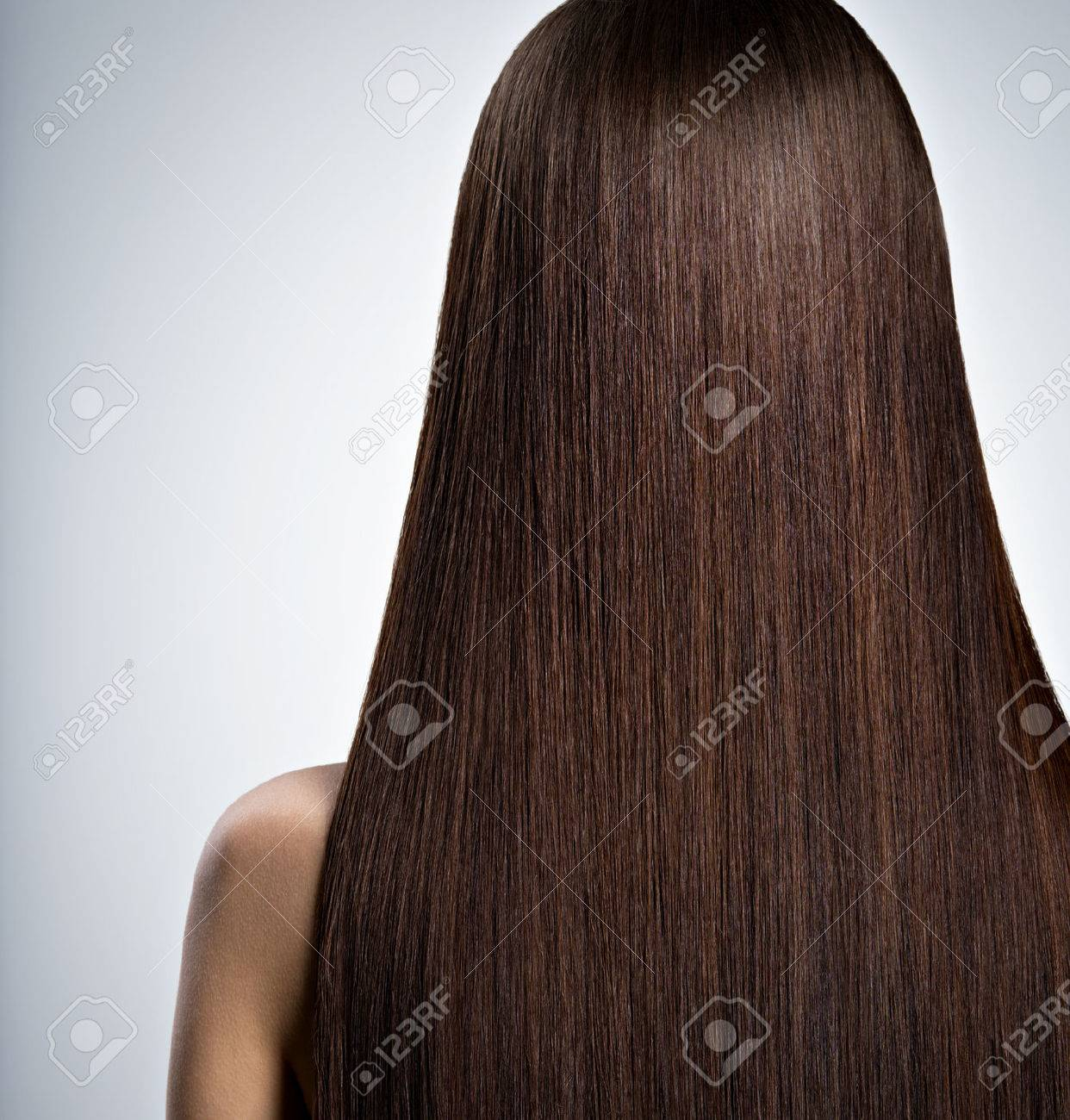 Rear Portrait of woman with long brown straight hair at studio - 54099999