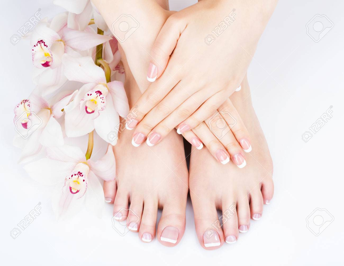 Closeup photo of a female feet at spa salon on pedicure and manicure procedure - Soft focus image Banque d'images - 54100863