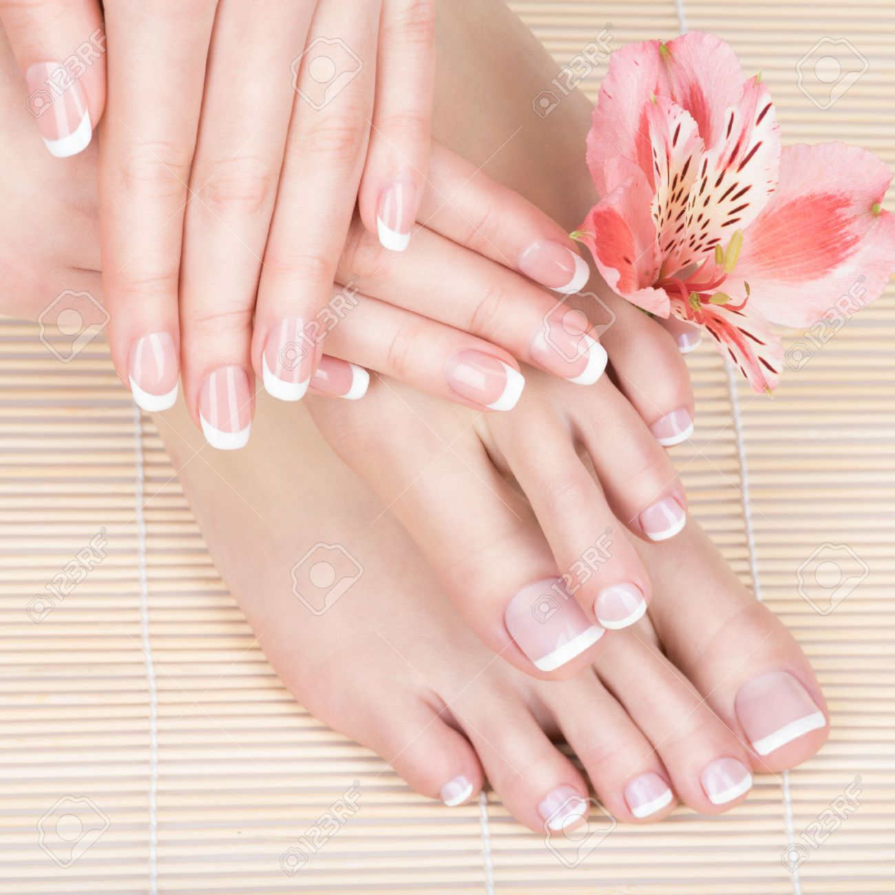 Closeup photo of a female feet at spa salon on pedicure and manicure procedure - Soft focus image Banque d'images - 54100873