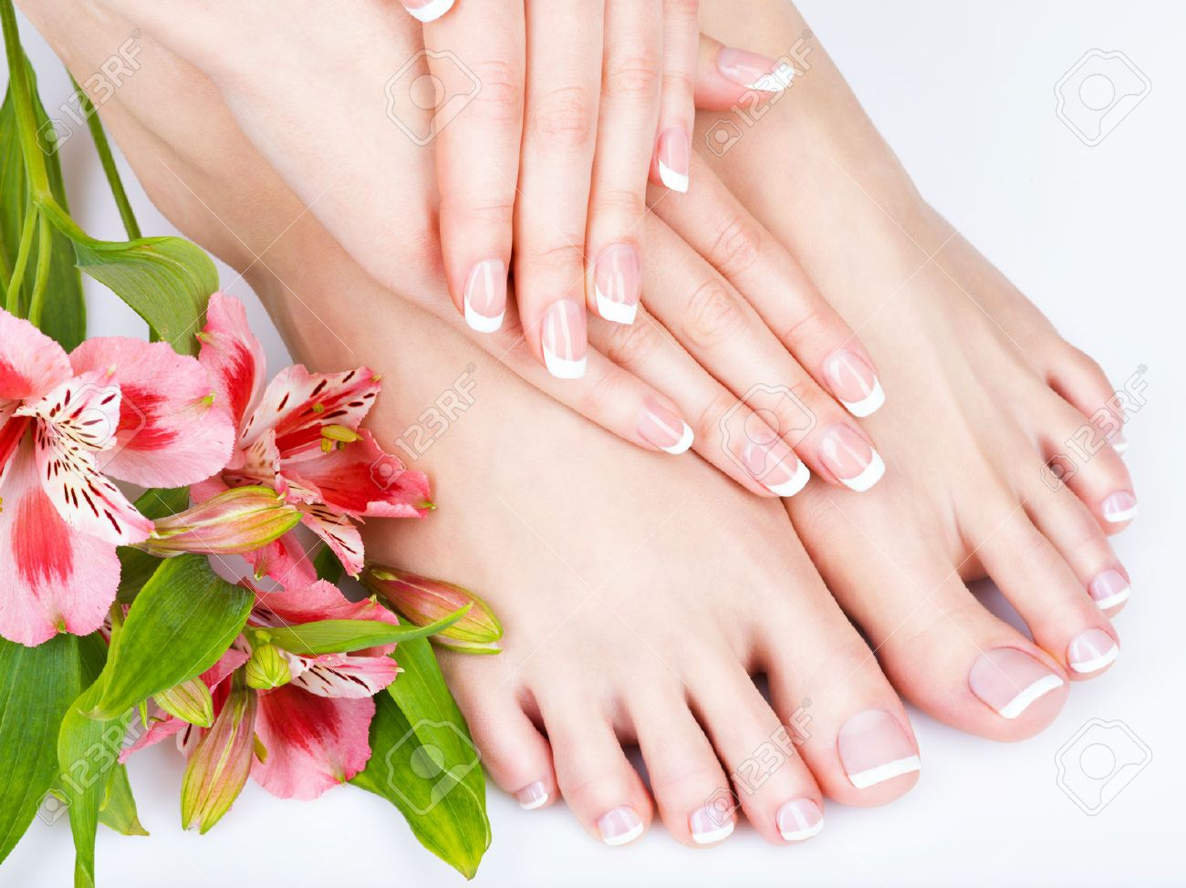 Closeup photo of a female feet at spa salon on pedicure and manicure procedure - Soft focus image Banque d'images - 54100908