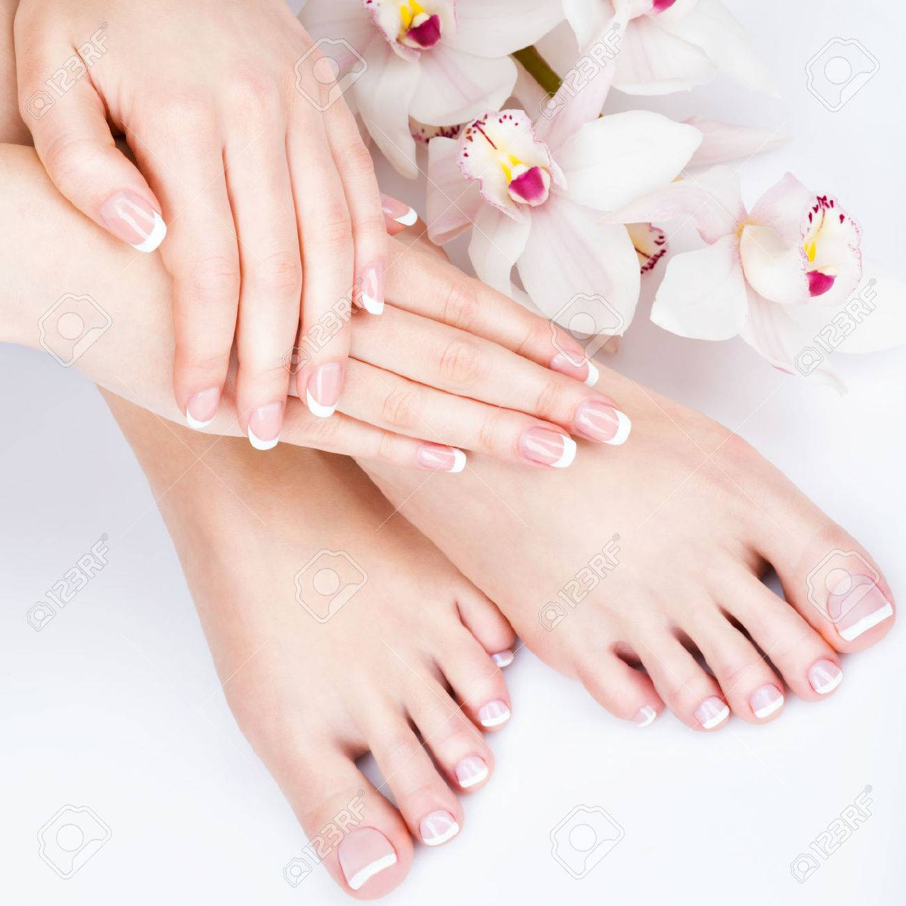 Closeup photo of a female feet at spa salon on pedicure and manicure procedure - Soft focus image Banque d'images - 54100930