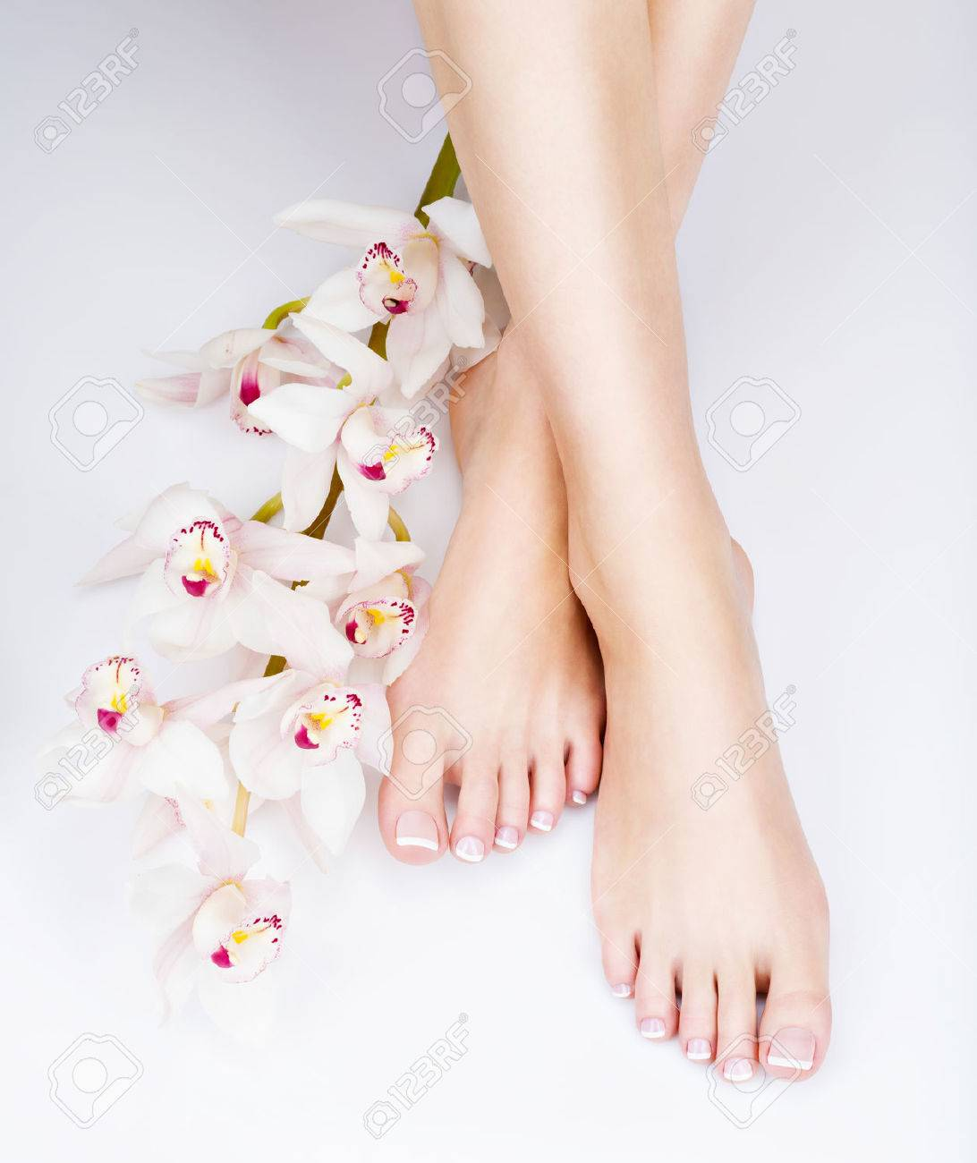 Closeup Photo Of A Female Feet With White French Pedicure On.. Stock ...