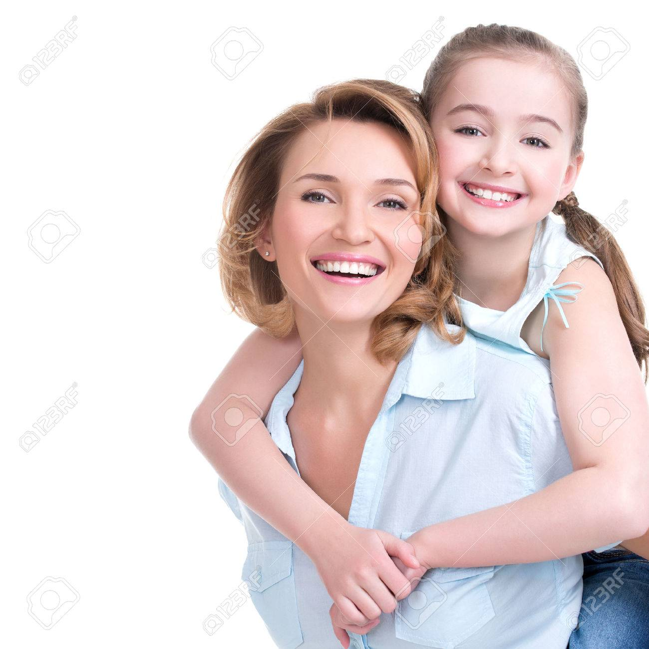 CLoseup portrait of happy  white mother and young daughter - isolated. Happy family people concept. Banque d'images - 54101540
