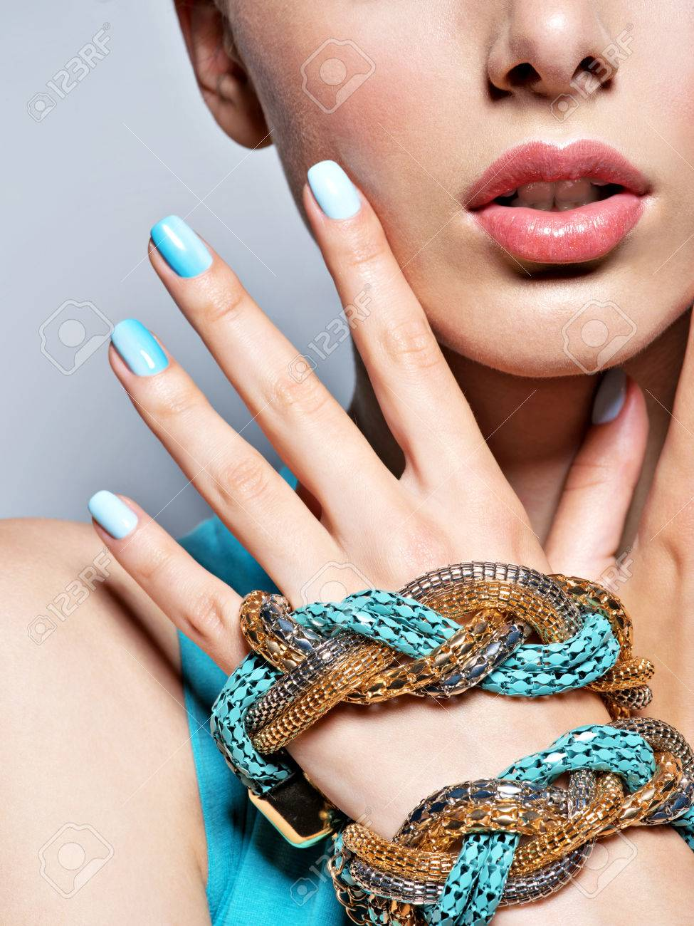 woman hands nails manicure fashion blue jewelry. Female hands with blue fingernails - 54178190