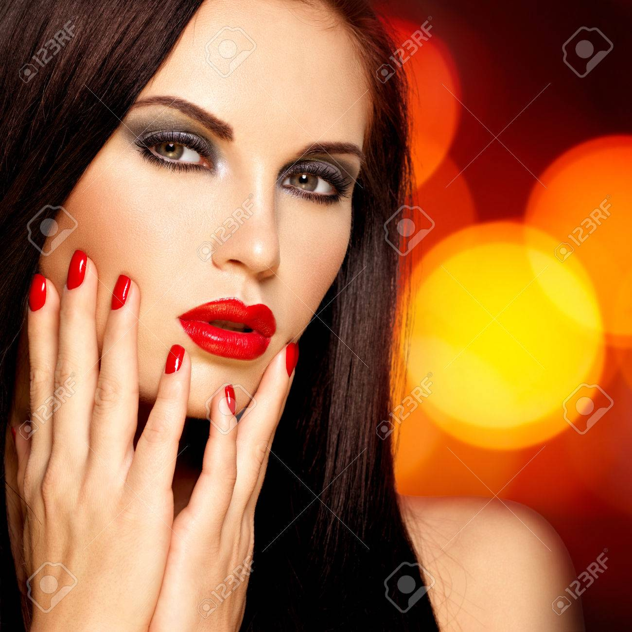 Beautiful Brunette Woman With Red Lips And Nails. Face Of A.. Stock ...