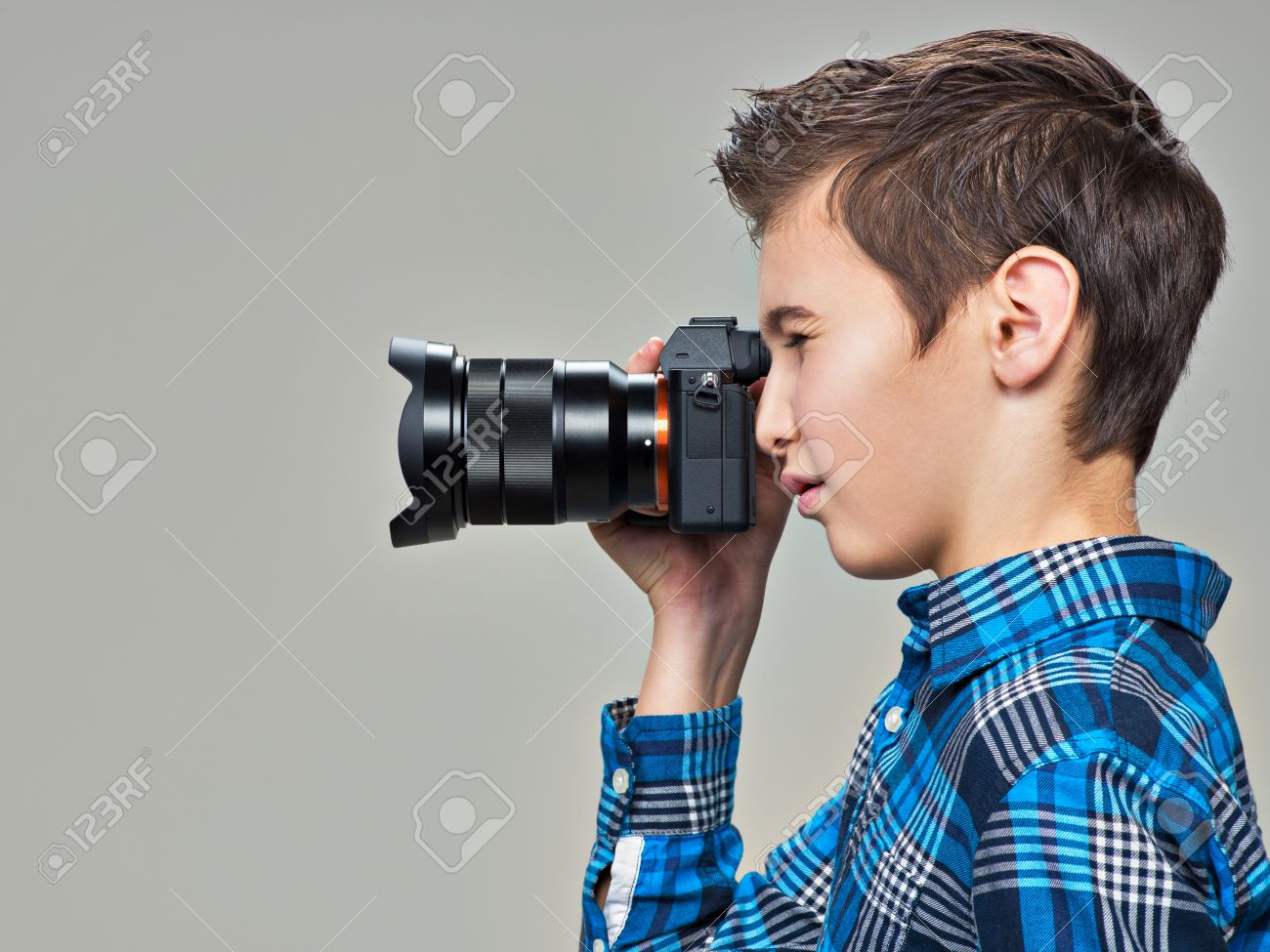 Boy With Photo Camera Taking Pictures Teen Boy With Dslr Camera