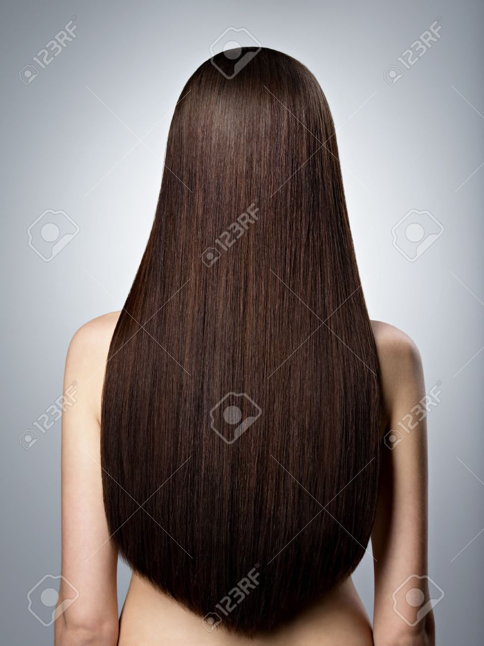Rear Portrait Of Woman With Long Brown Straight Hair At Studio Banco
