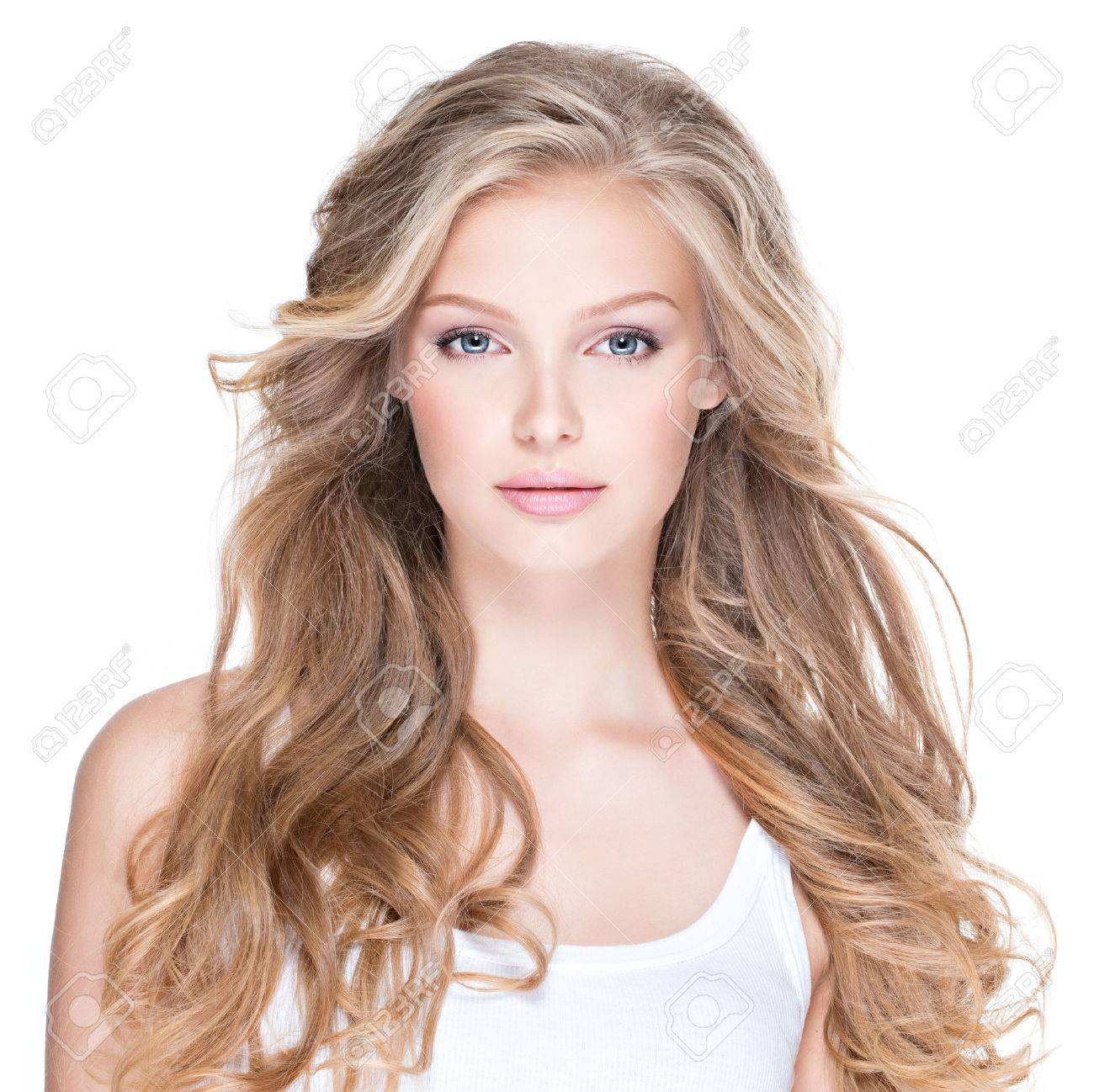 Portrait of beautiful happy young woman with long curly hair - isolated on white. Banque d'images - 63182894