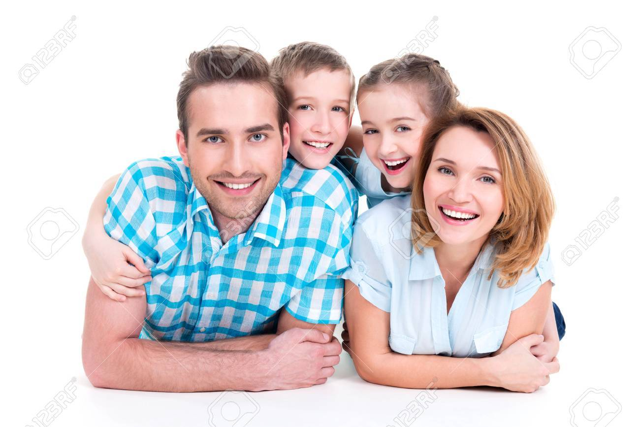 Caucasian happy smiling young family with two children lying down on the floor - 62833658