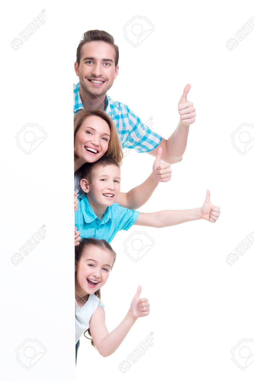 Young family with a banner showing the thumbs-up sign - isolated on a white background Banque d'images - 63194219
