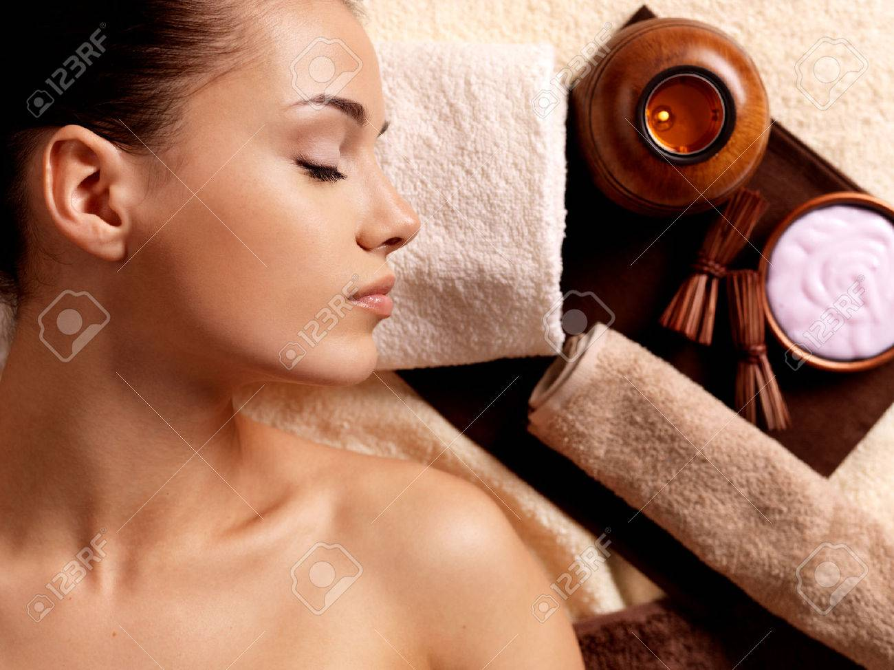 Calm woman after massage relaxing in spa salon. Beauty treatment concept. - 62833667