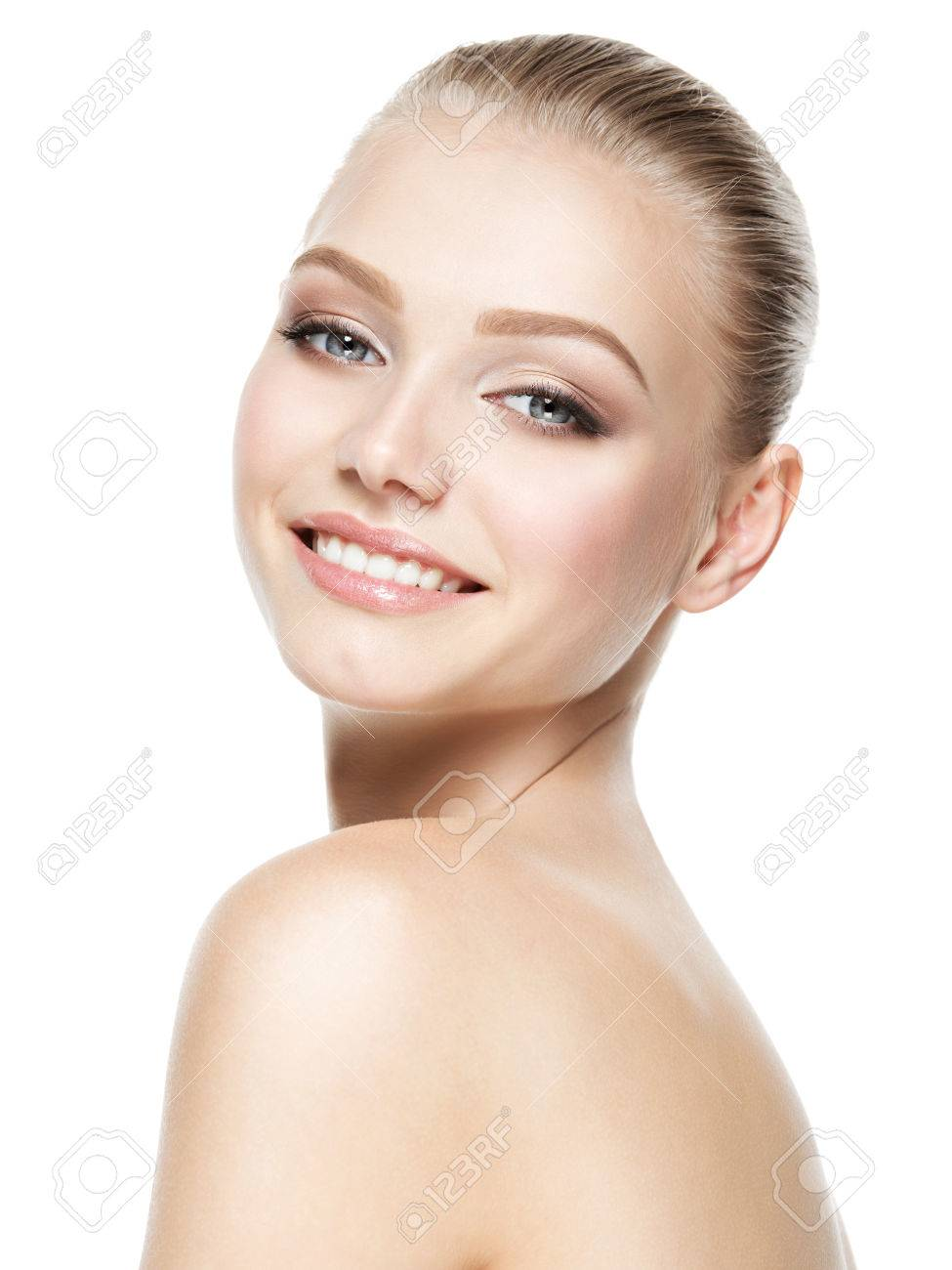 Beautiful face of young smiling woman with clean fresh skin - isolated on white Banque d'images - 63650597
