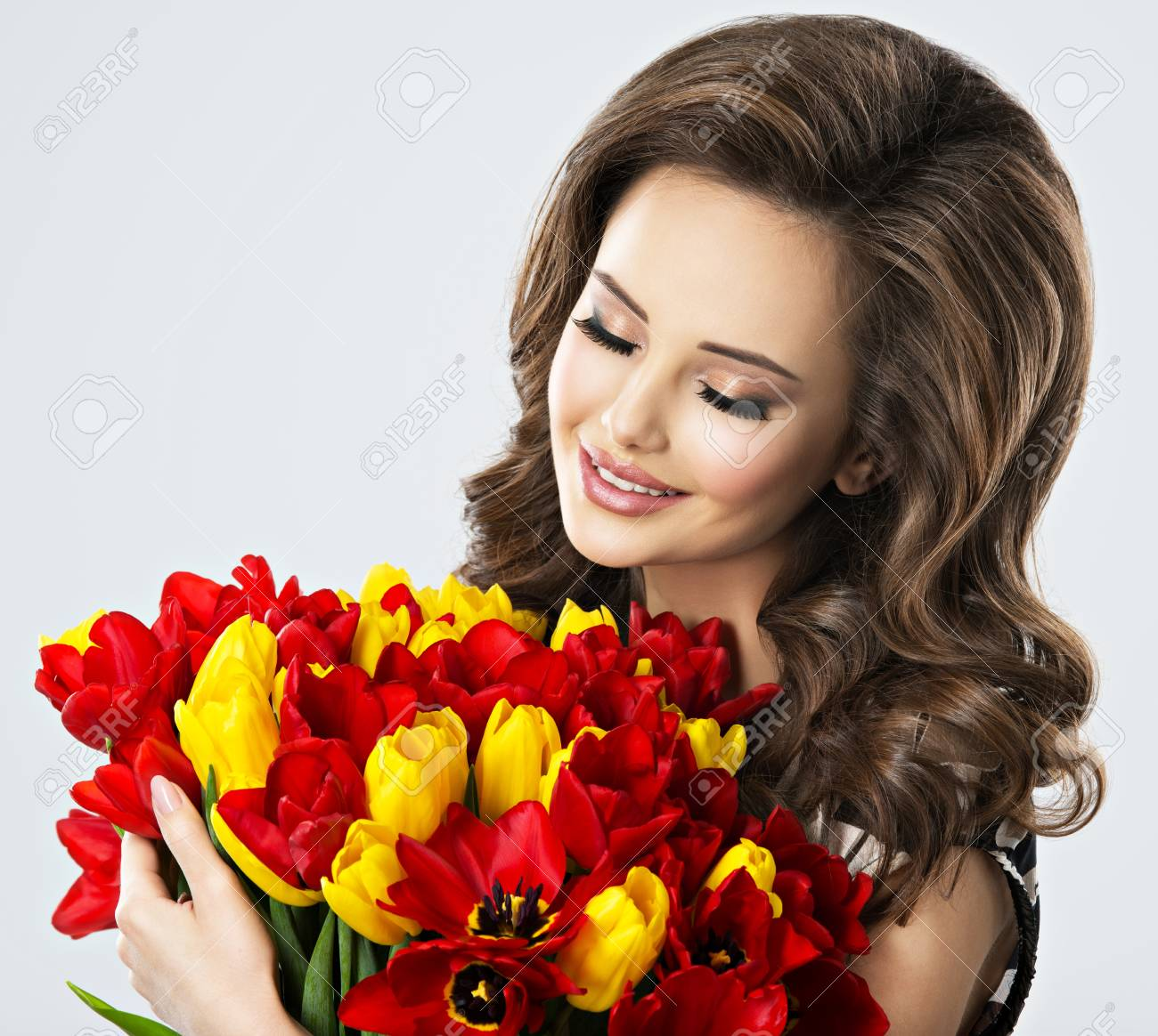 Portrait of calm beautiful woman with flowers in hands stock photo portrait of calm beautiful woman with flowers in hands stock photo 66159378 izmirmasajfo