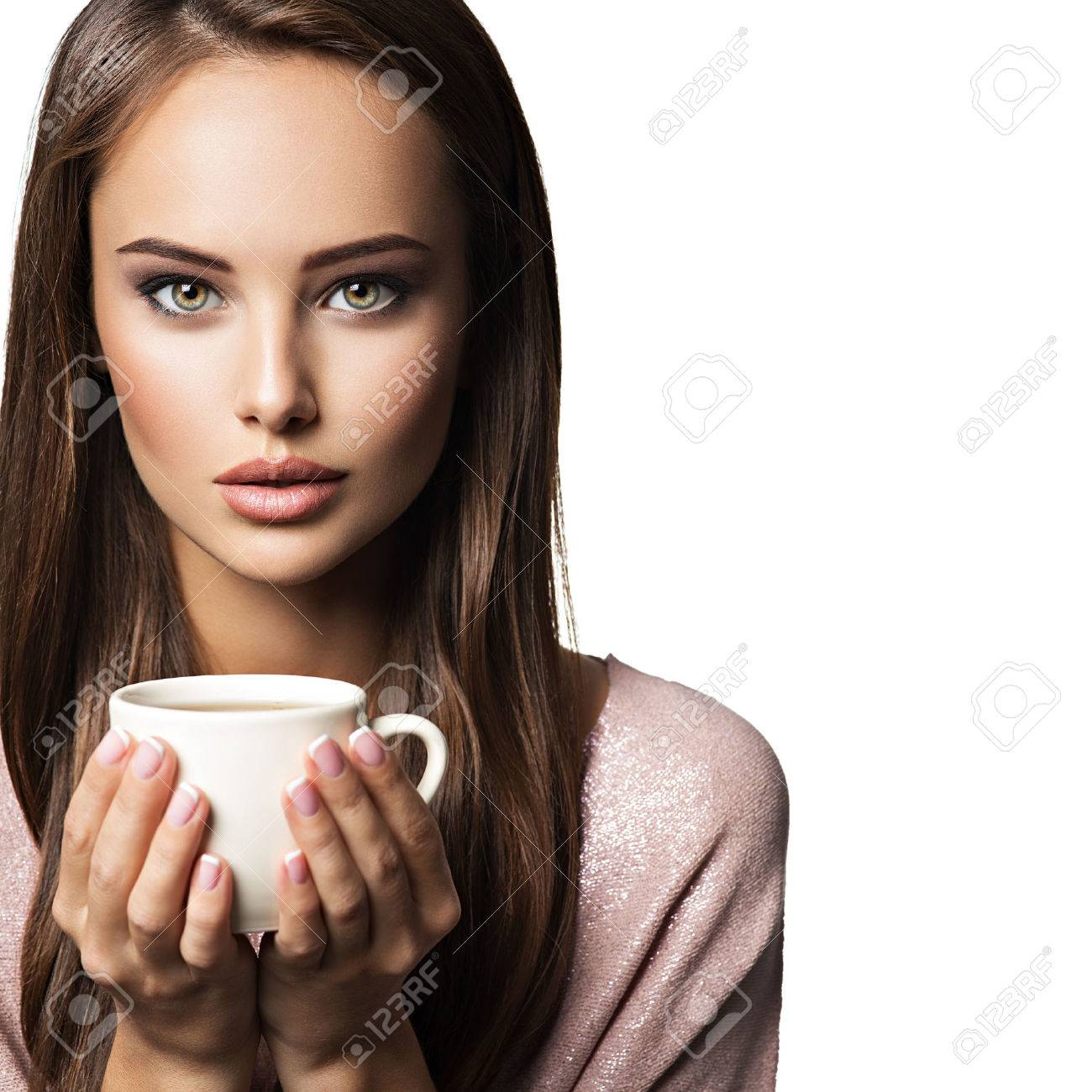 Woman with cup of coffee. Beautiful adult girl hods in hands mug with hot drink - on white background Stock Photo - 70218393