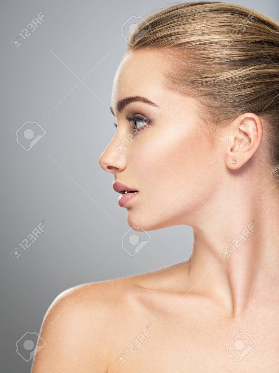 Profile face of young woman, skin care treatment. Side view of beautiful girl with healthy skin of the face - 88948565