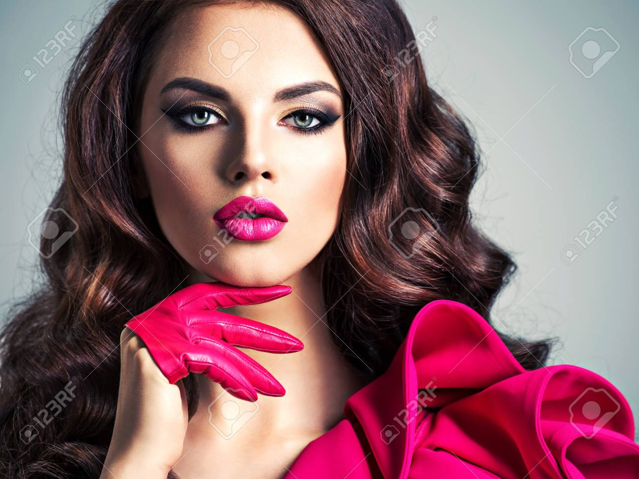 Fashionable Woman In A Red Dress With A Creative Eye Makeup