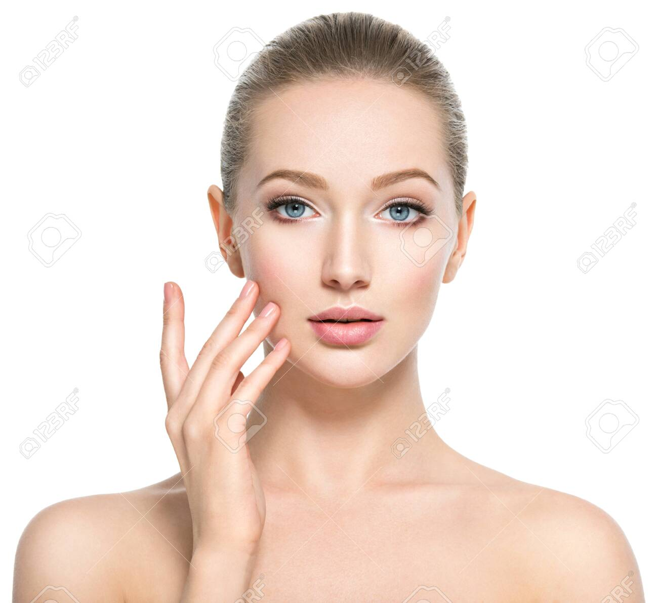 Beautiful face of young caucasian woman with perfect health skin - isolated on white. Skin care concept. Female Model touches face. - 122677847