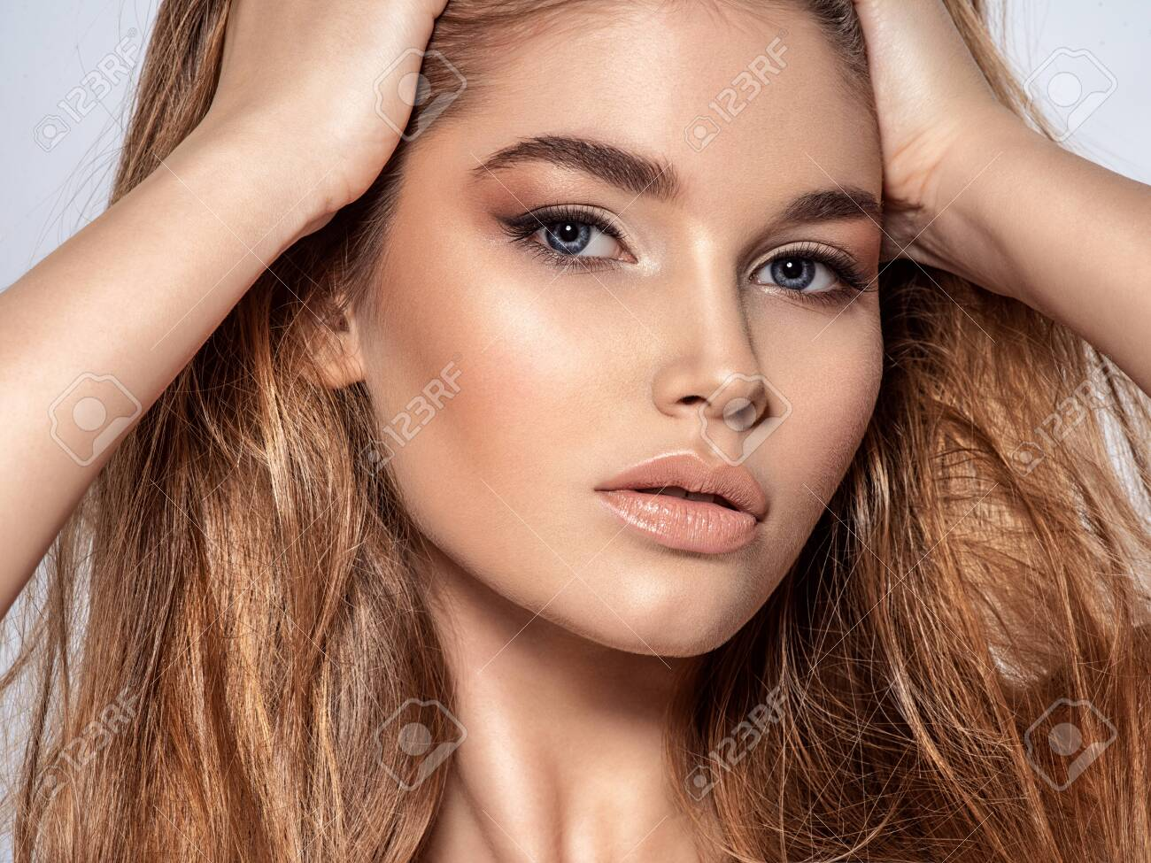 Woman With Beauty Long Brown Hair And Natural Makeup Beautiful Stock Photo Picture And Royalty Free Image Image 129600520
