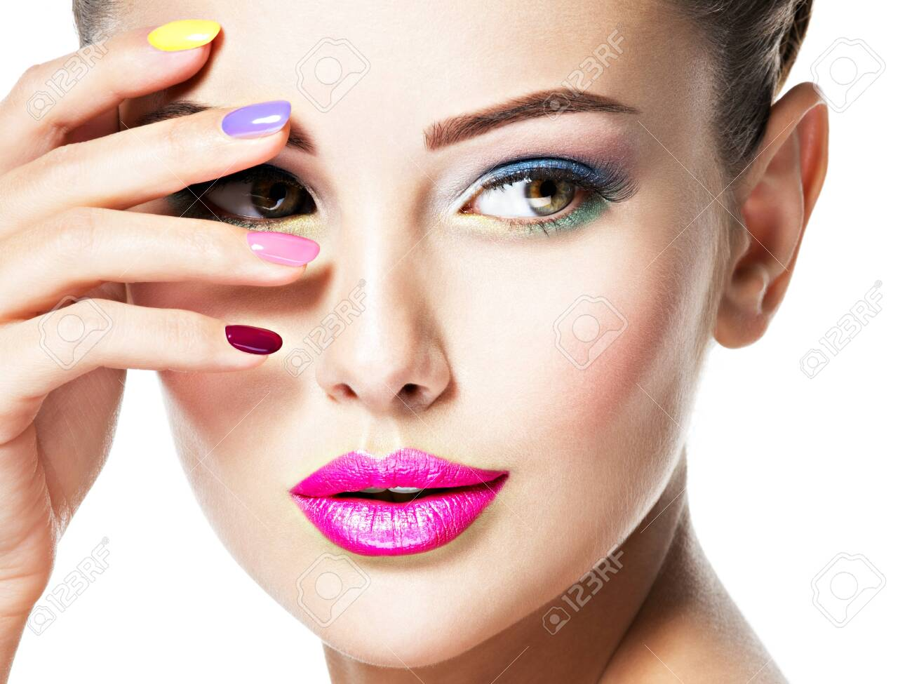 Close-up face of a beautiful woman with multicolor nails and fashion makeup . - 135458513
