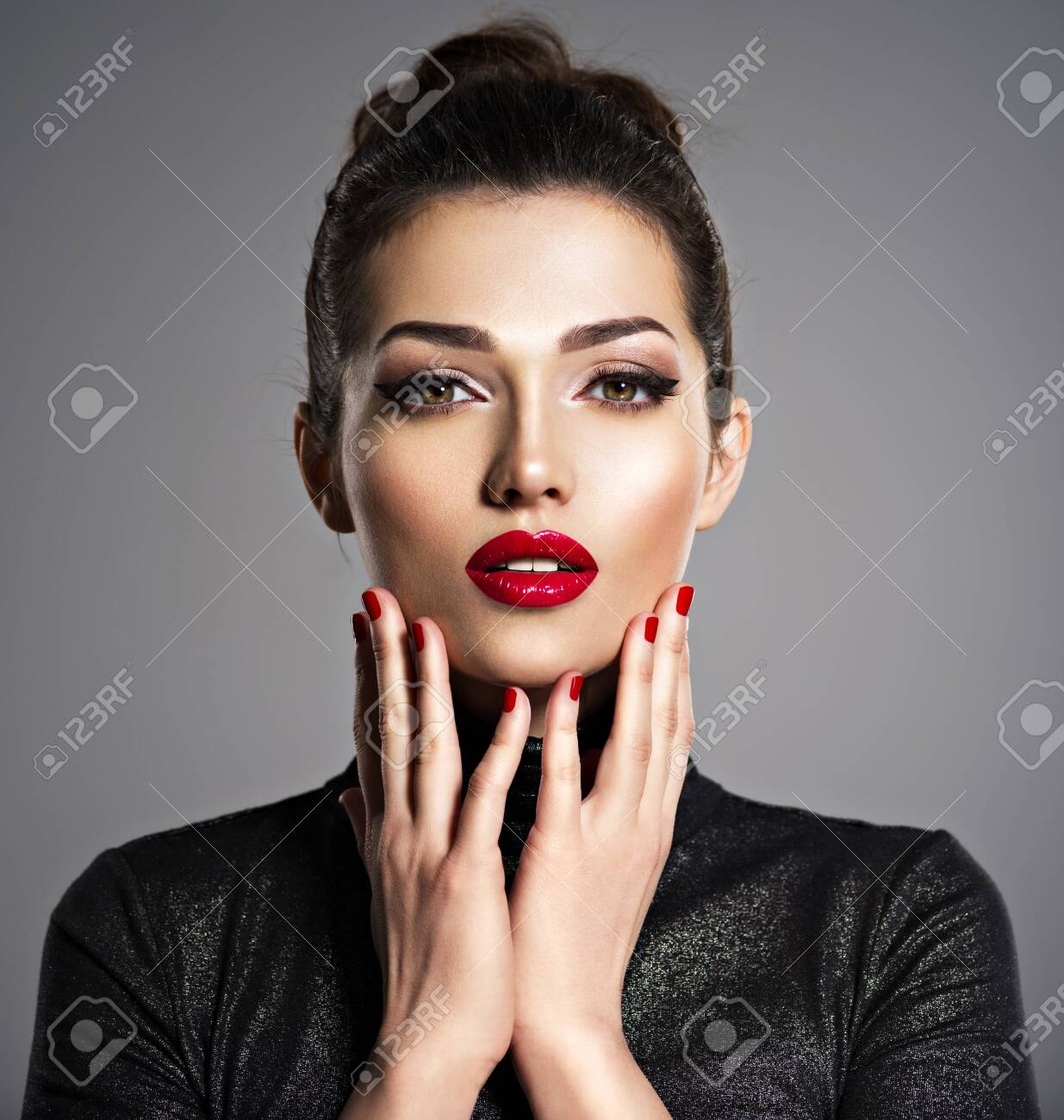 Closeup portrait of beautiful woman with bright make-up and red nails. Sexy young adult girl with red lipstick. - 139477148