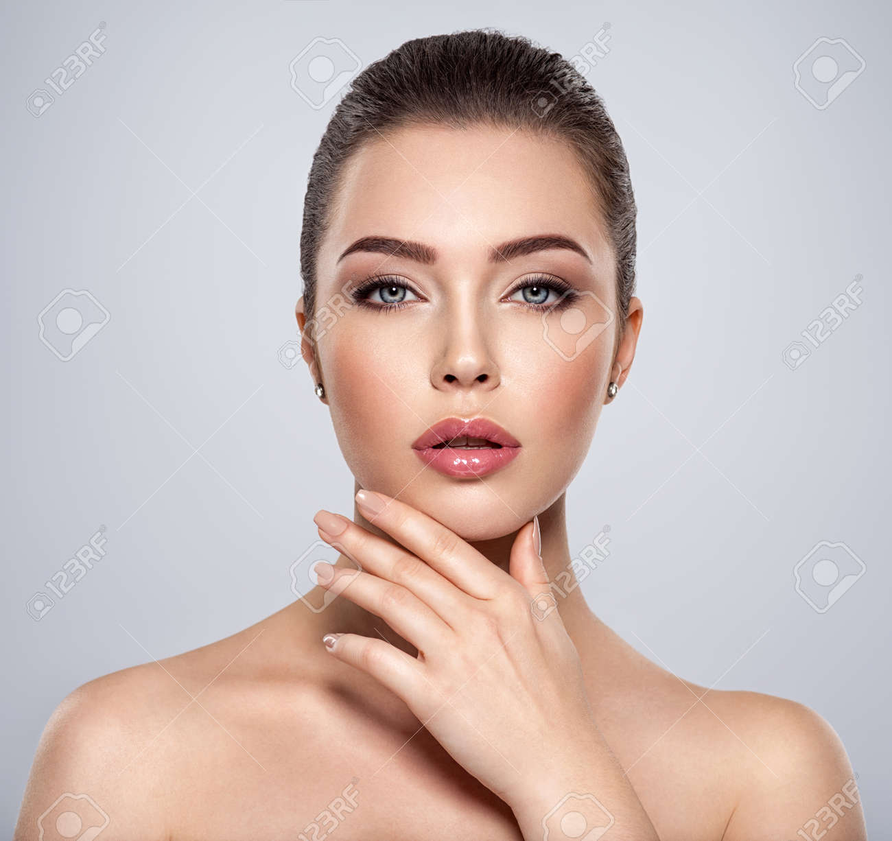 Front portrait of the woman with beauty face - isolated. Beauty face of the young beautiful girl with a healthy skin. Closeup portrait of an attractive female with a beautiful eyes. Skin care concept. - 157677506