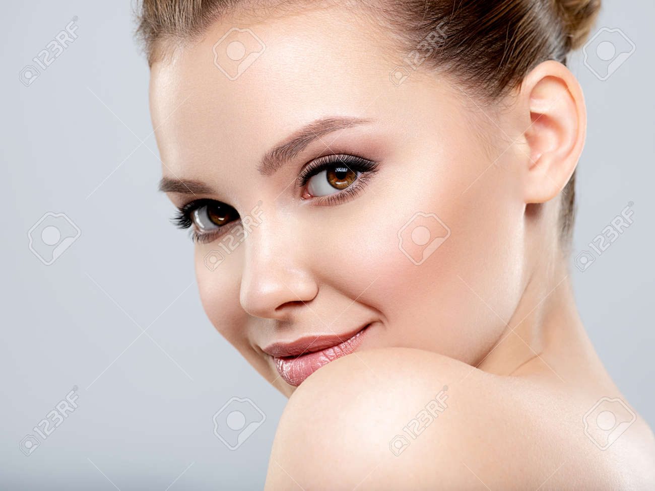 Beautiful face of young smiling woman with clean fresh skin - isolated. Young white happy woman with a clean skin. - 166251413