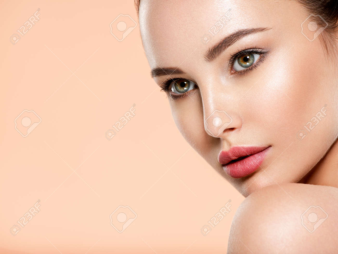 Beautiful face of young woman with health fresh skin. Portrait of beautiful brunette woman with clean face. Closeup face of young adult woman with clean fresh skin. Skin care. - 166421677