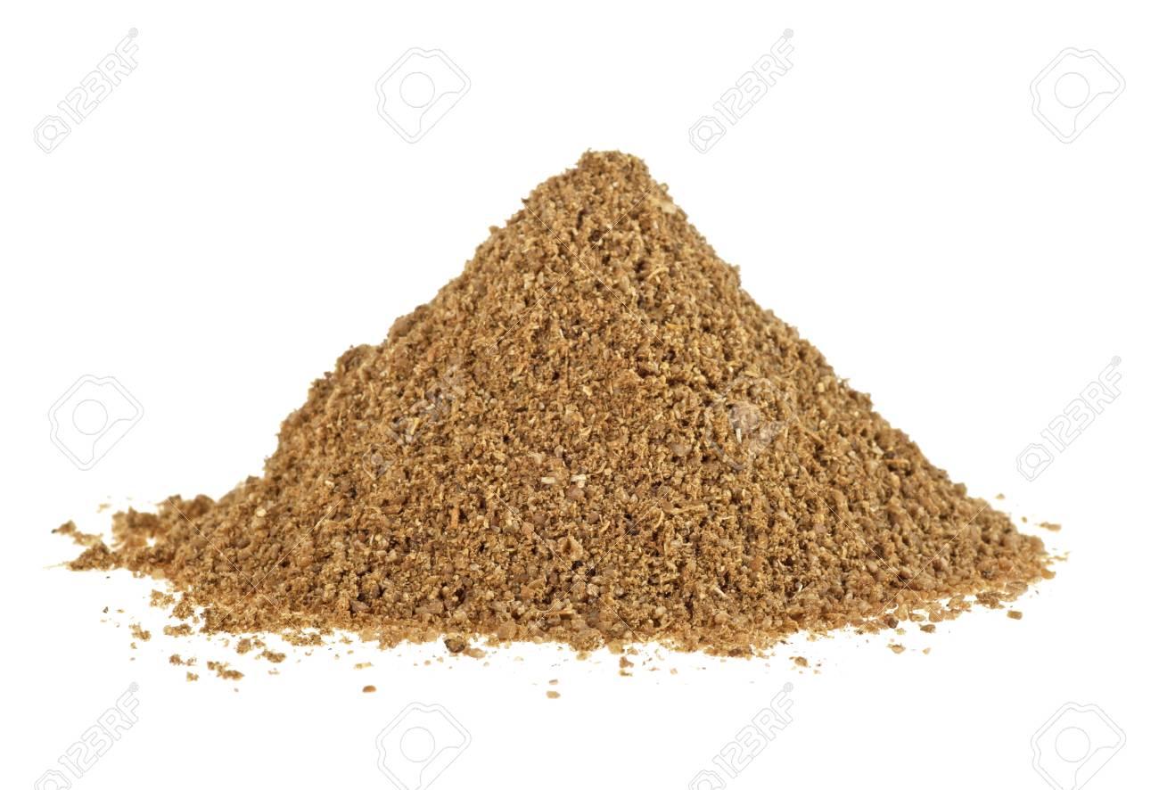 Heap of coriander powder on white background - 93242159