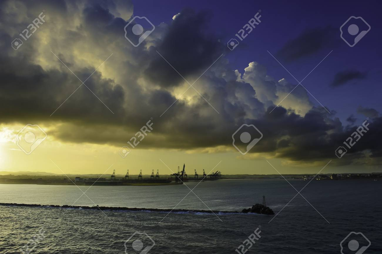 Cranes for cargo containers at the breakwater, Port of Colon Panama at sunrise Stock Photo - 10836569