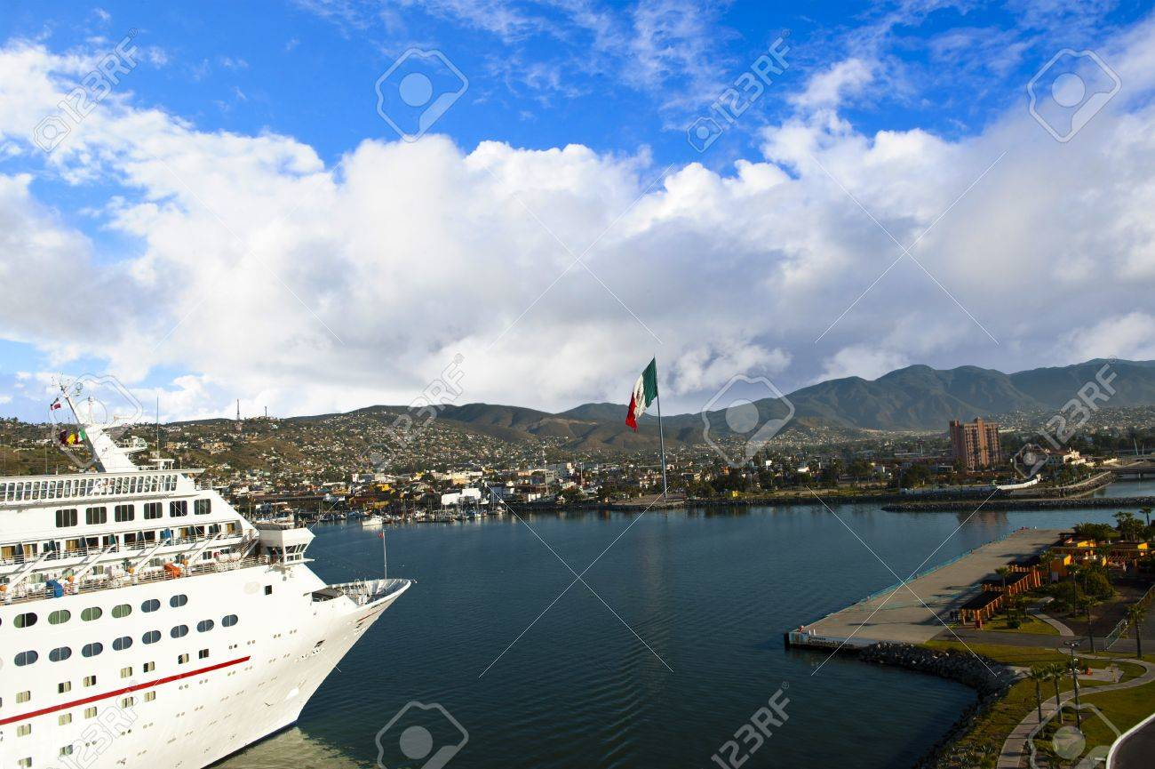 A Cruise Ship Docking In Ensenada Mexico With The Mexican Flag - Flying cruise ship