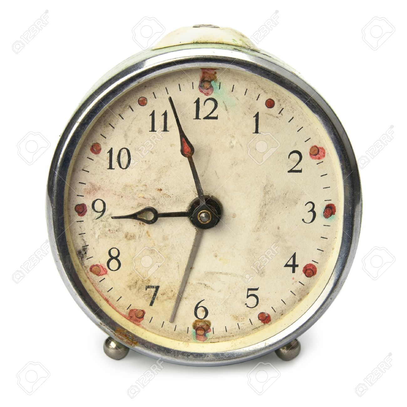 old broken vintage alarm clock isolated on white stock photo