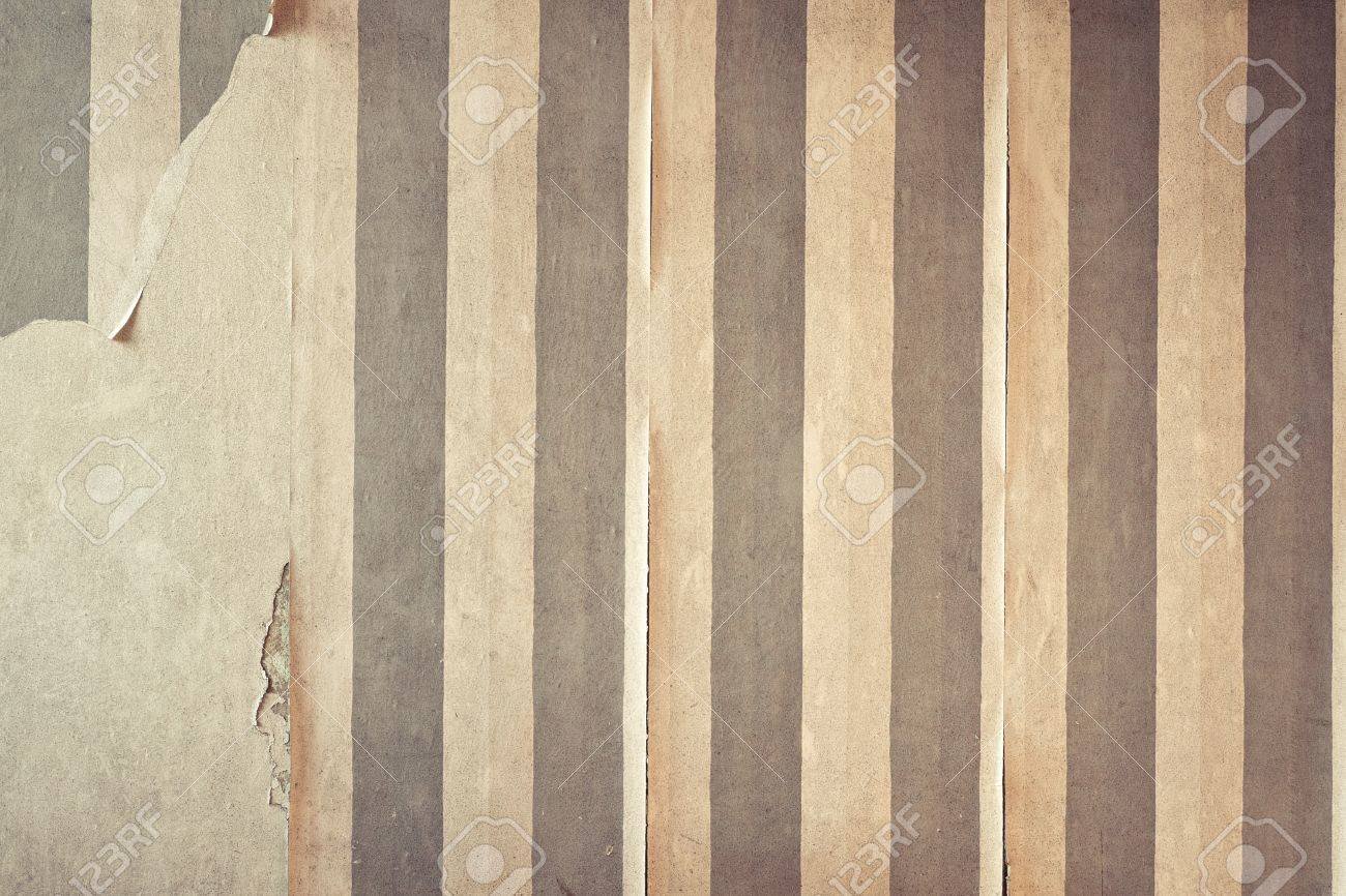 Aged room wall background with torn wallpaper. Stock Photo - 9261178
