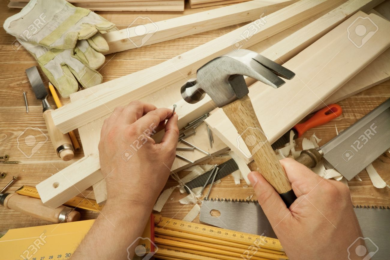Wooden Workshop Table With Tools Man S Arms Hammering A Nail Stock