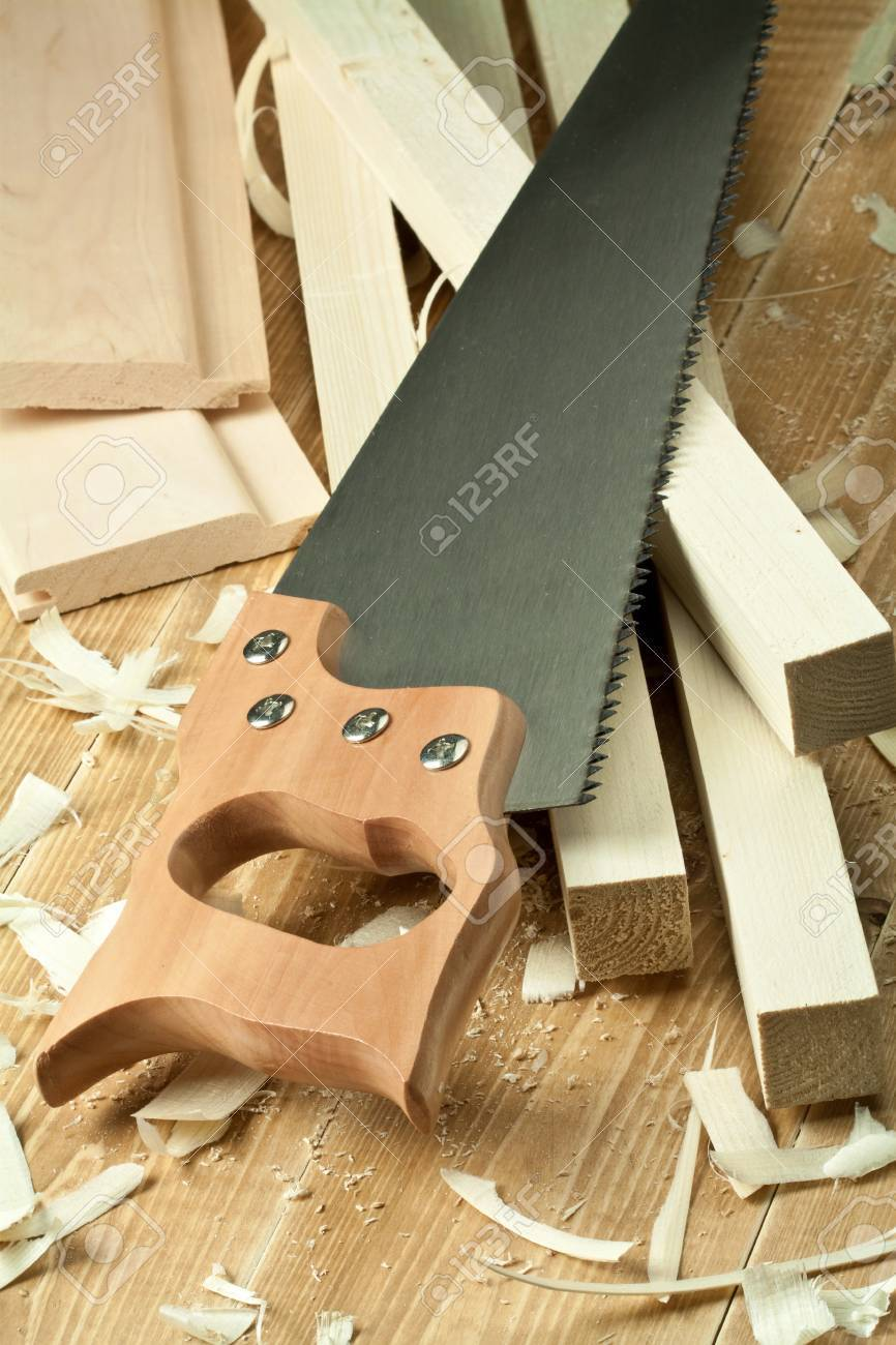 Wood workshop. Hand saw over planks. Stock Photo - 9568970