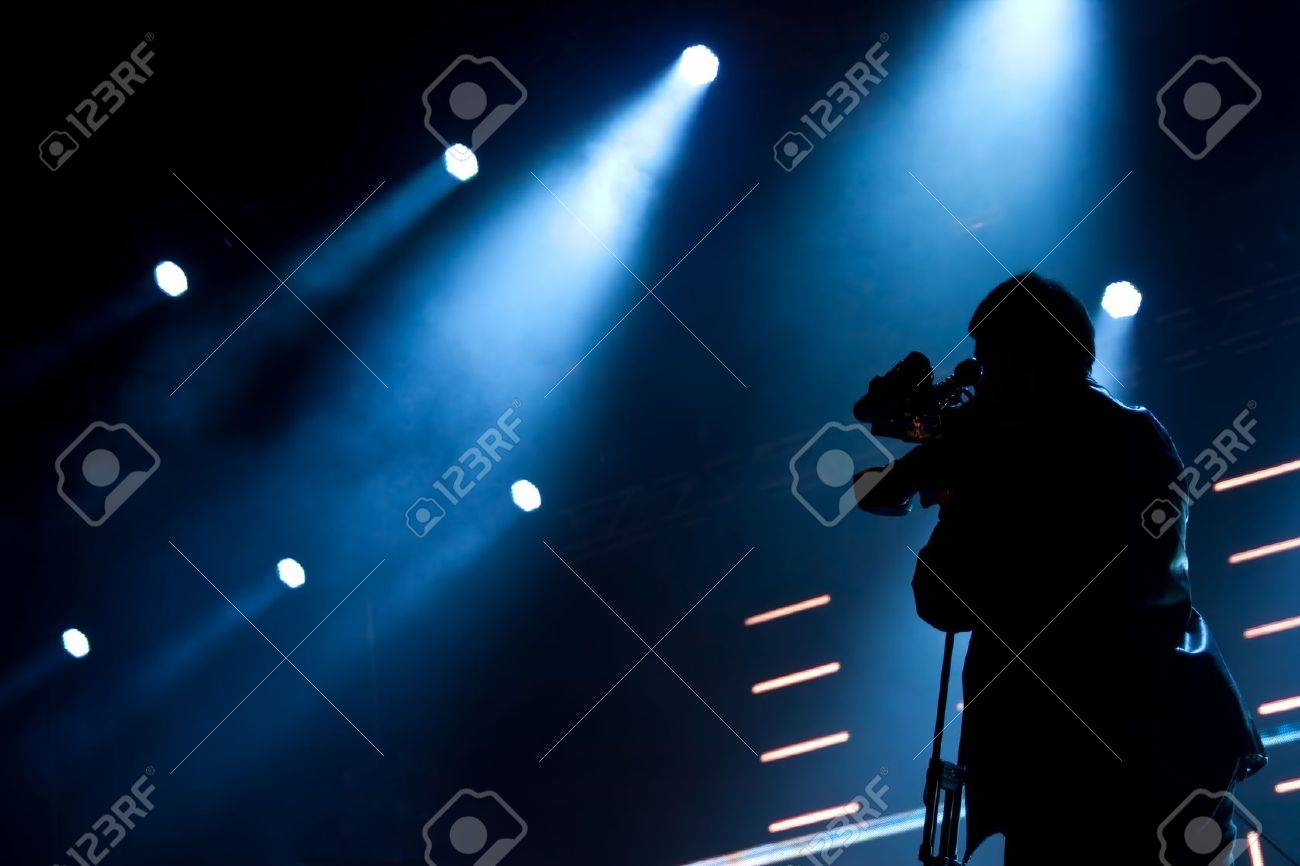Cameraman silhouette on a concert stage Stock Photo - 10498701