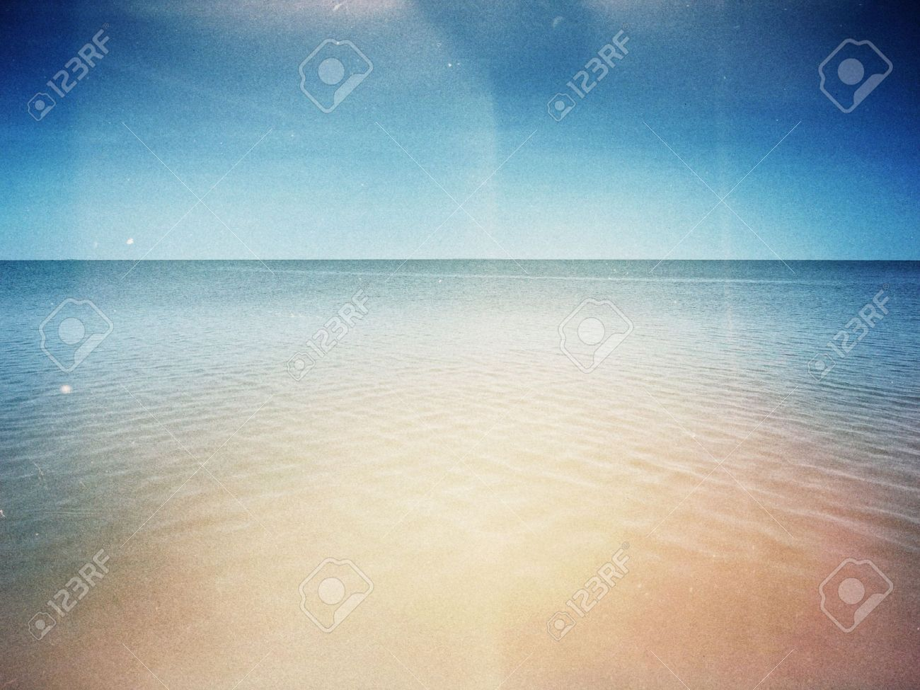 Designed retro photo. Sunny day on the beach. Grain, dust, colors added as vintage effect. Stock Photo - 11312130