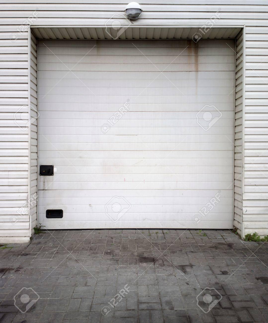 Close white garage doors Stock Photo - 14517614