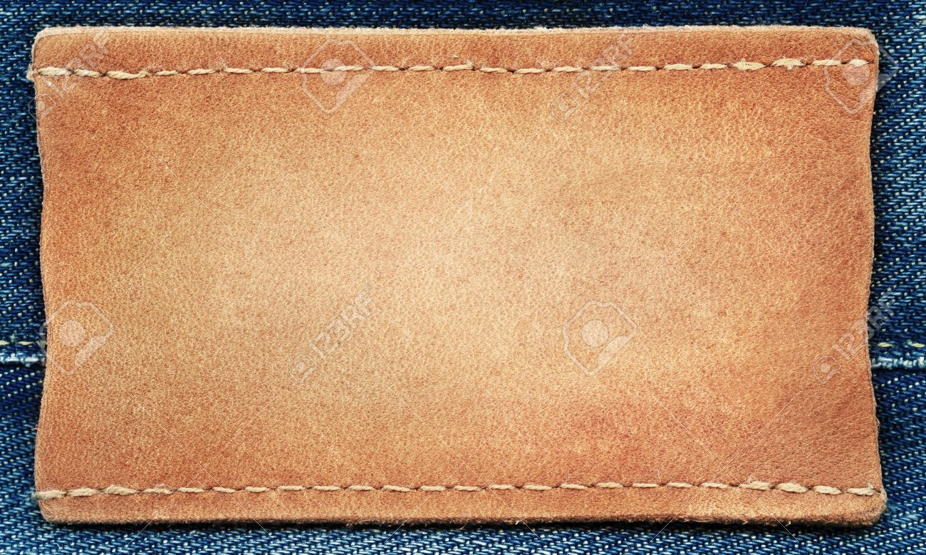 blank leather jeans label sewed on a blue jeans stock photo picture