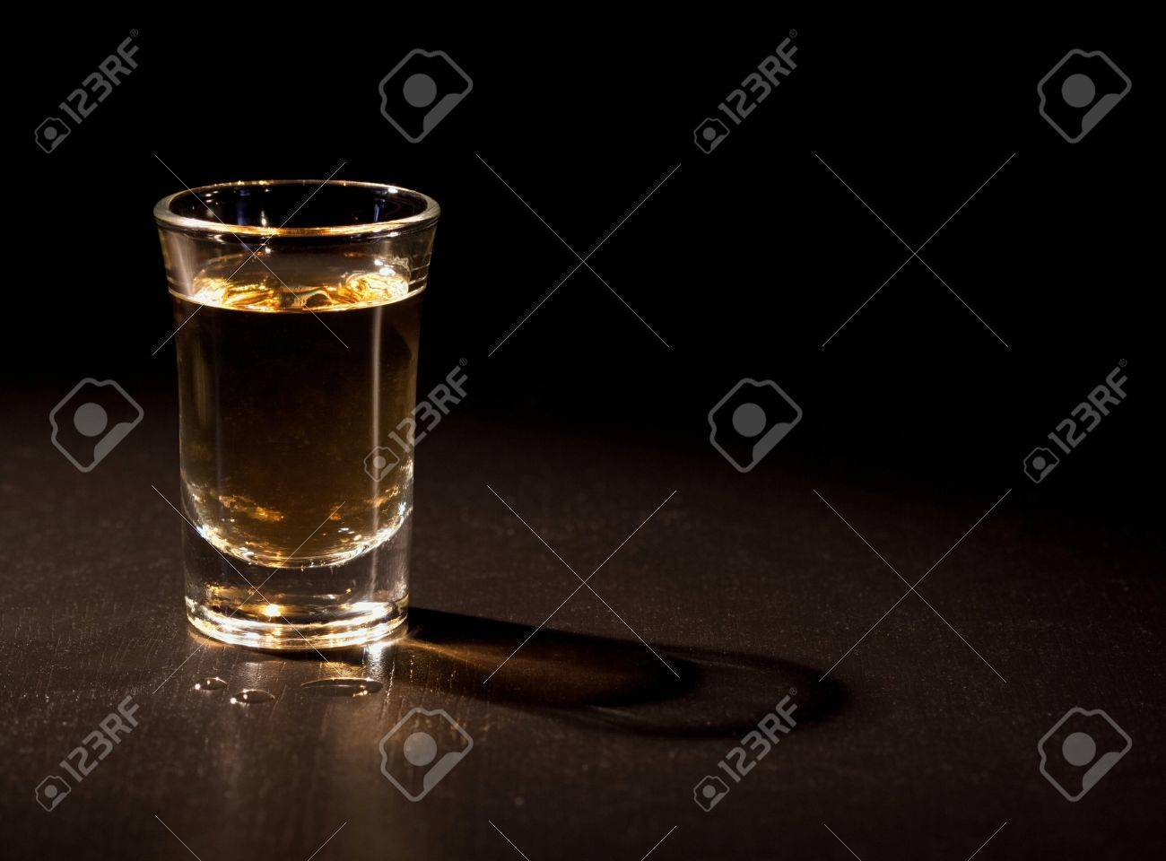 Whiskey shot in a dark bar Stock Photo - 17095590
