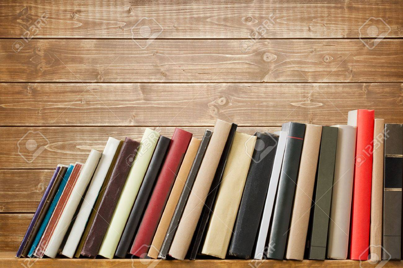 Books Shelf old books on a wooden shelf. no labels, blank spine. stock photo