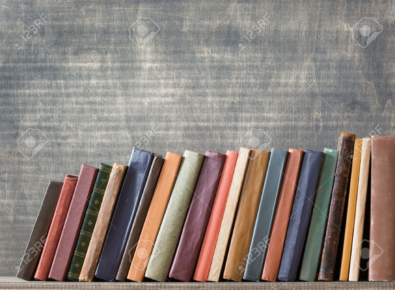 Books Shelf old books on a wooden shelf. stock photo, picture and royalty free