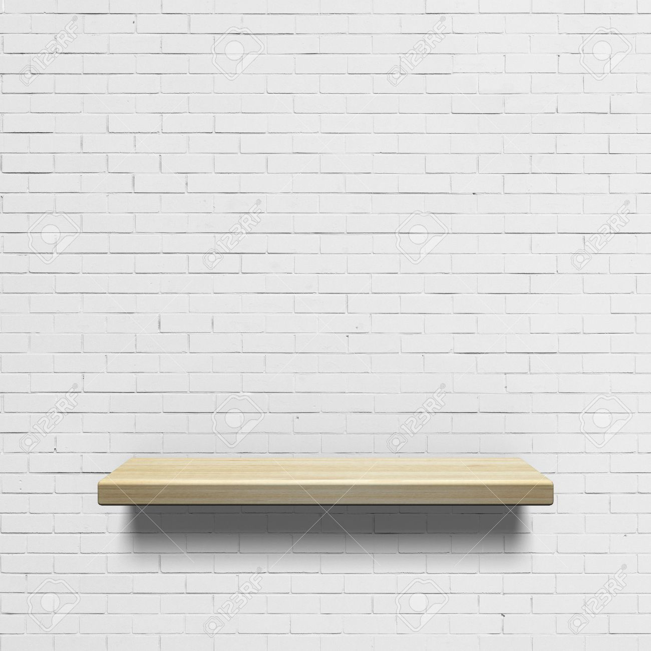 Wooden shelf on a white brick wall Stock Photo - 30409765