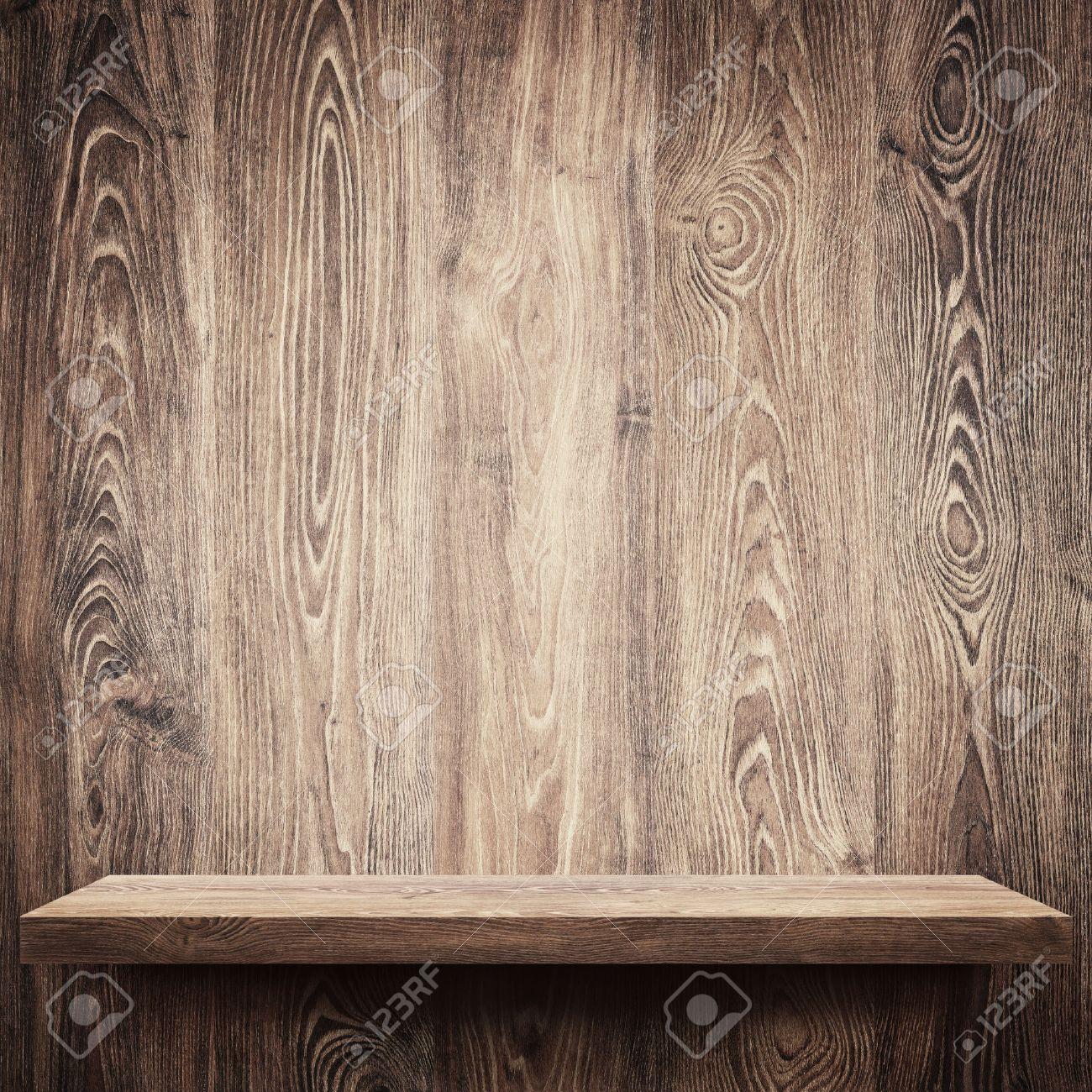 Empty shelf on wooden wall Stock Photo - 31206891